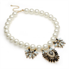 Access Gold effect white pearl, crystal and black tone colour bead necklace.