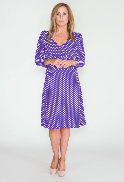 Zapara royal blue dress in polka dot print.